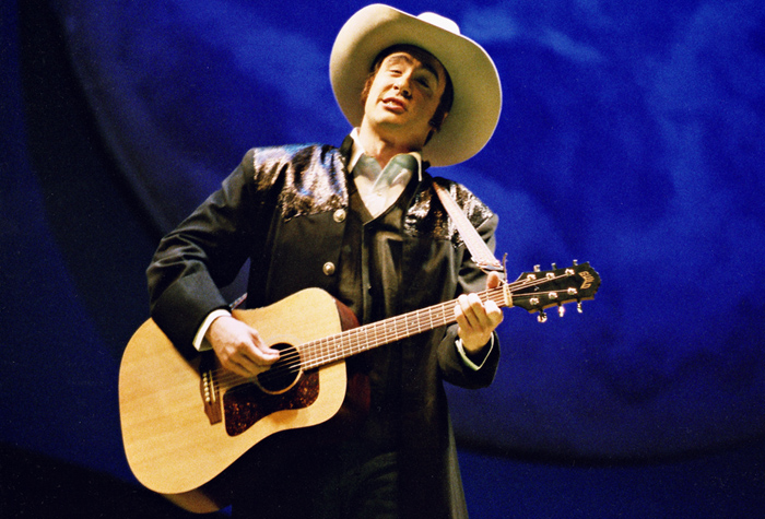 Accompanying himself on the guitar as the Narrator in Britten's Paul Bunyan, Central City Opera debut, 2005